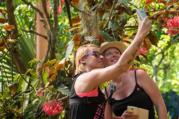 EYKPGD Visitors taking selfie photo at Vallarta Botanical Garden, Puerto Vallarta, Mexico.. Image shot 2015. Exact date unknown.