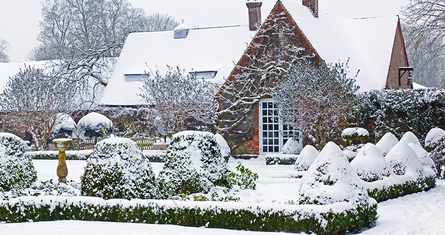 Snow covered Chenies Manor Gardens, Buckinghamshire, UK